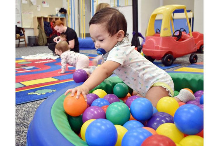 Axel Ramos, 10 months, plays in a ball pit during the New Parent Support Program Playgroup at the Sagamihara Family Housing Area, Japan, Jan. 7, 2020. (Photo by Winifred Brown)