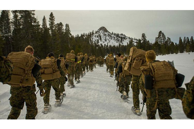 """U.S. Marines with Combat Logistics Battalion 11, 1st Marine Logistics Group, conduct a """"snowshoe tour"""" during Mountain Exercise 2-18 at Marine Corps Mountain Warfare Training Center in Bridgeport, California. (Photo by Marine Corps Sgt. James Trevino, 1st Marine Logistics Group.)"""