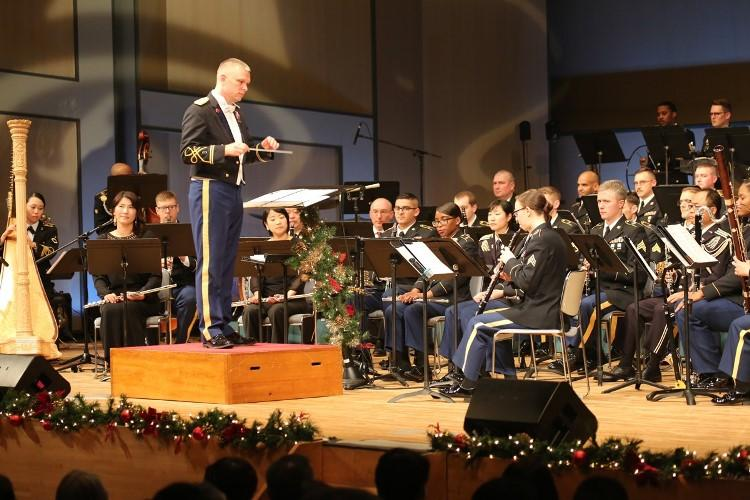 "Chief Warrant Officer 2 Richard Chapman, left, commander of the U.S. Army Japan Band, conducts the band during their seventh annual performance, this year titled ""An American Concert,"" held Dec. 20 and 21, 2019, at Zama Harmony Hall in Zama City. (Photo Credit: Noriko Kudo, U.S. Army Garrison Japan Public Affairs)"