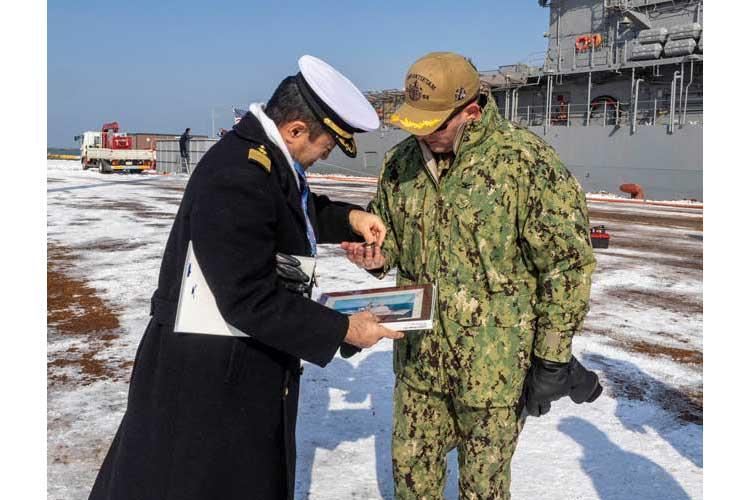 ISHIKARI, Japan (Feb. 03, 2019) Capt. George Kessler, Jr., from Albany, Missouri, is greeted by Capt. Takuya Suzuki of the Japanese Maritime Self Defense Force Yoichi Coastal Defense Group, after Ticonderoga-class guided-missile cruiser USS Antietam (CG 54) pulled into Ishikari to attend the 70th Annual Sapporo Snow Festival. (Photo by Lt. Marissa Liu)
