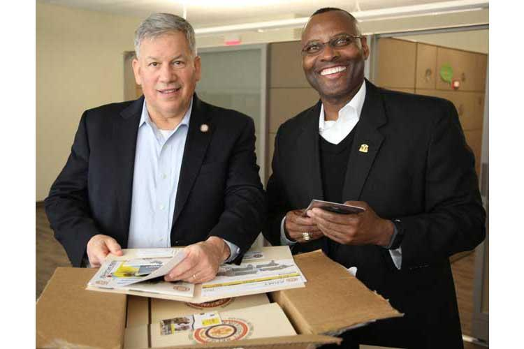 Retired Army Lt. Gen. Raymond V. Mason, director of Army Emergency Relief (left), and retired Army Command Sgt. Maj. Charles E. Durr Jr., AER chief of assistance, review AER educational materials at IMCOM headquarters Jan. 23. (Photo Credit: Susan A. Merkner, IMCOM Public Affairs)