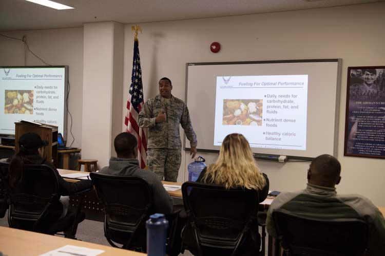U.S. Air Force Tech Sgt. Anthony Nelson, a 35th Air Medical Squadron public health flight chief, teaches Airmen about proper nutrition during a Wild Weasels University nutrition and fitness class. Eighteen attendees participated earning them each a certificate of completion and new knowledge to guide their health. (U.S. Air Force photo by Branden Yamada)
