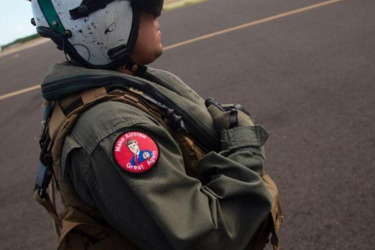 "A Navy helicopter crew chief wears a ""Make Aircrew Great Again"" morale patch at the Barking Sands missile range in Hawaii, July 12, 2018. Sailors have been reprimanded for wearing the same patch during a speech by President Donald Trump the following year. (STARS AND STRIPES)"