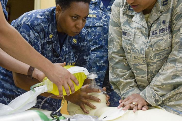Navy Chief Petty Officer Wendy Wright, a hospital corpsman chief assigned to Expeditionary Medical Facility Great Lakes in Illinois, performs ventilation techniques on a practice mannequin while participating in a life support simulation in Savannah, Georgia. (U.S. Air Force photo by Staff Sgt. Caila Arahood)