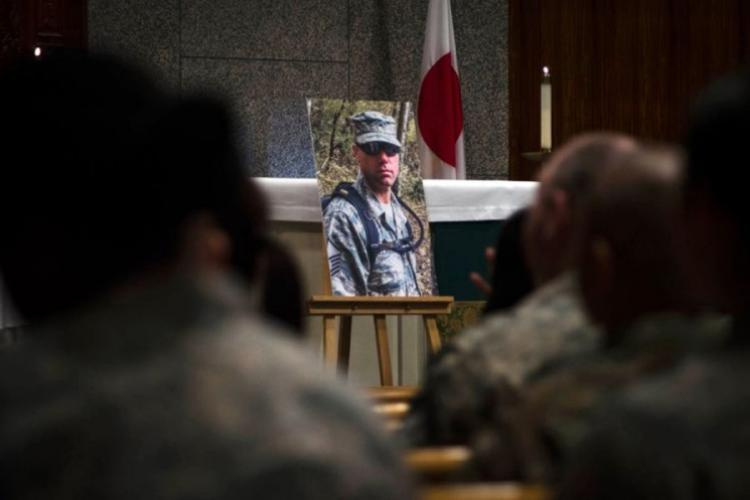 Service members attend a memorial ceremony for Master Sgt. Nicholas Vollweiler at Yokota Air Base, Japan, Nov. 16, 2018. (THERON GODBOLD/STARS AND STRIPES)