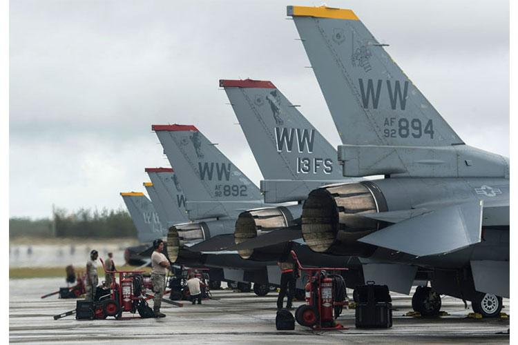 U.S. Air Force Airmen from the 13th Fighter Squadron, Misawa Air Base, Japan, stands by for F-16 Fighting Falcon's to taxi onto a runway at Andersen Air Force Base, Guam, during COPE North 19, Feb. 19, 2019. COPE North is an annual multilateral U.S. Pacific Air Forces-sponsored field training exercise and paused Feb. 22 as a precautionary measure due to hazardous conditions caused by Typhoon Wutip. (U.S. Air Force Photo by Senior Airman Xavier Navarro)