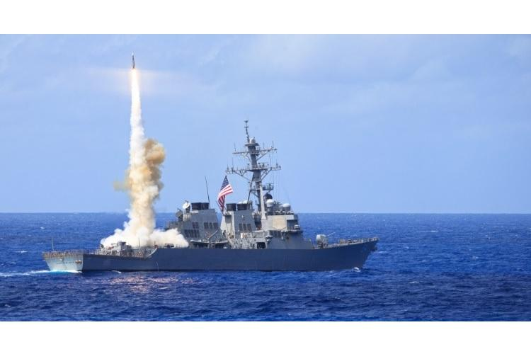 Arleigh Burke-class guided-missile destroyer USS Curtis Wilbur (DDG 54) fires a Standard Missile 2 (SM-2) during a missile firing exercise. Curtis Wilburn is participating in Multi-Sail 2014, an annual exercise in the 7th Fleet area of responsibility supporting security and stability in the Indo-Asia-Pacific region. (U.S. Navy Photo by Fire Controlman 2nd Class Kristopher G. Horton/Released)