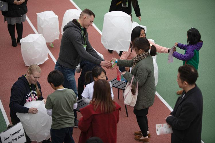 U.S. service members with Marine Aircraft Group 12 volunteer during a lantern festival in Iwakuni City, Japan, March 3, 2019. The service members volunteered in the event that was held by the Blue Art Project, a non-profit organization that is dedicated to people with developmental disorders. (U.S. Marine Corps photo by Cpl. Andrew Jones)