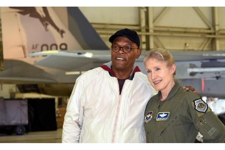 "Actor Samuel L. Jackson poses with Gen. Jeannie Leavitt after receiving a challenge coin from her during a media event for ""Captain Marvel"" at Edwards Air Force Base, Calif., Feb. 20, 2019. Leavitt, the first Air Force female fighter pilot, was a consultant on the movie, and Jackson reprised his Nick Fury role. (DoD photo by Shannon Collins)"
