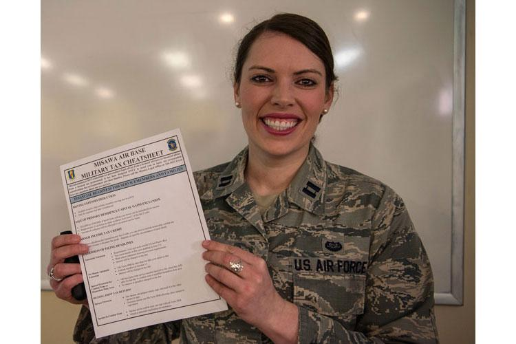 U.S. Air Force Capt. Courtney Marshall, the 35th Fighter Wing legal office chief of international law, shows a military tax cheat sheet during a tax seminar at Misawa Air Base, Japan, Feb. 28, 2019. The seminar gave guidance on step-by-step procedures of tax filing. (U.S. Air Force photo by Airman 1st Class Xiomara M. Martinez)