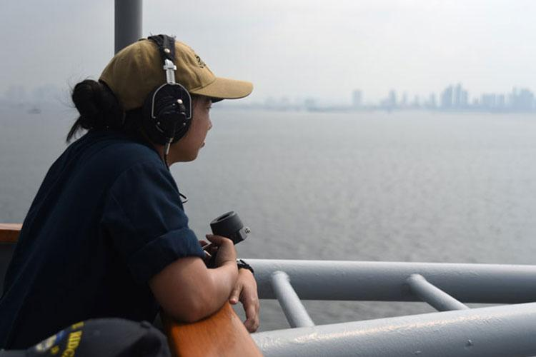 MANILA, Philippines (March 13, 2019) - Quartermaster Seaman Irish Catibog, from Guam, performs her duties as a lookout aboard U.S. 7th Fleet Flagship USS Blue Ridge (LCC 19) as the ship arrives for a port visit to Manila, Philippines. Blue Ridge is the oldest operational ship in the Navy, and as 7th Fleet command ship, is responsible for fostering relationships within the Indo-Pacific Region. (Photo by Mass Communication Specialist 3rd Class Dylan McKay)