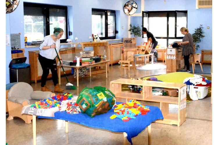 Staff members on a U.S. base in Germany deep clean a child development center as a precaution against coronavirus on March 19, 2020. Similar measures were taken at centers in Japan. (KEITH PANNELL/U.S. ARMY)