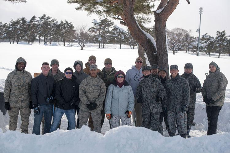 "U.S. Air Force Airmen with the 35th Civil Engineer Squadron emergency management flight and Japan Air Self-Defense Force members pause for a photo during the inaugural ""Snowblast"" event at Misawa Air Base, Japan, Feb. 14, 2019. The emergency flight gathered for a snowball fight and capture the flag events with members of JASDF. This event provided an opportunity for Airmen to bond with their host-nation counterparts. (U.S. Air Force photo by 1st Lt. Jeremy Garcia)"