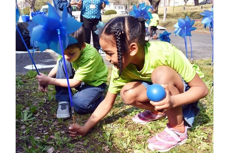 Children from the Camp Zama Child Development Center plant pinwheels for Child Abuse Awareness Month at Camp Zama Army Community Service March 27. (Photo Credit: Wendy Brown, U.S. Army Garrison Japan Public Affairs)