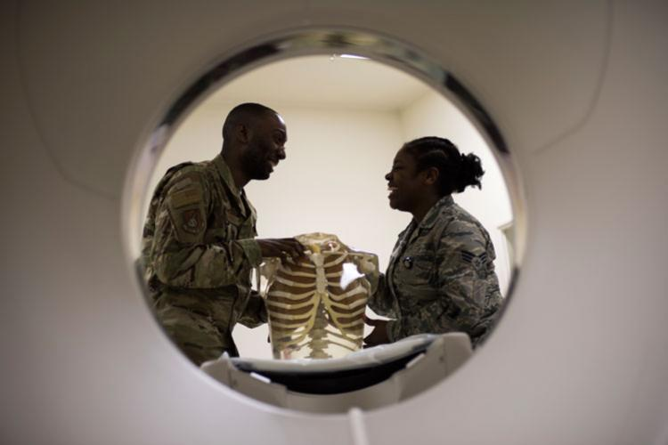 U.S. Air Force Senior Airmen William Gathers III, left, and Shirell Montague, right, both 35th Surgical Operations Squadron radiology technologists, have a laugh at work while inspecting a skeleton model at Misawa Air Base, Japan, April 10, 2019. Medical professionals use human skeletons as learning tools to aid in training by expanding Airmen's knowledge and skills. (U.S. Air Force photo by Senior Airman Collette Brooks)