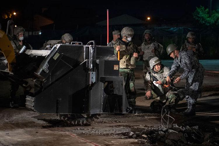 374th Civil Engineer Squadron Airmen train Japan Air Self-Defense Force members on the process of cutting concrete slab as part of Rapid Airfield Damage Repair (RADR) practice, during Exercise Beverly Morning 19-01, at Yokota Air Base, Japan, May 15, 2019. Exercise Beverly Morning 19-01 gave CES and JASDF the opportunity to train together on RADR, the process of quickly and effectively repairing airfields, allowing for operations to continue during combat situations. (Airman 1st Class Brieana E Bolfing)