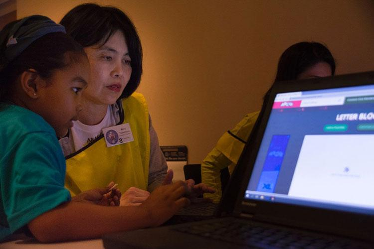 Mika Takemura, a teacher at Mekaru Elementary School on Okinawa, interacts with a Kadena Elementary School student during a workshop to enhance the English curriculum taught in Okinawa schools at Kadena, May 24, 2019. (CARLOS VAZQUEZ/STARS AND STRIPES)