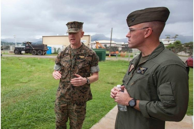 Then-Brig. Gen. Paul Rock Jr., left, commander of Marine Corps Installations Pacific, and Lt. Col. Nathaniel Baker, commander of Marine Corps Air Station Kaneohe Bay, speak outside the base's air traffic control tower, Oct. 15, 2018. (ZACHARY ORR/U.S. MARINE CORPS)