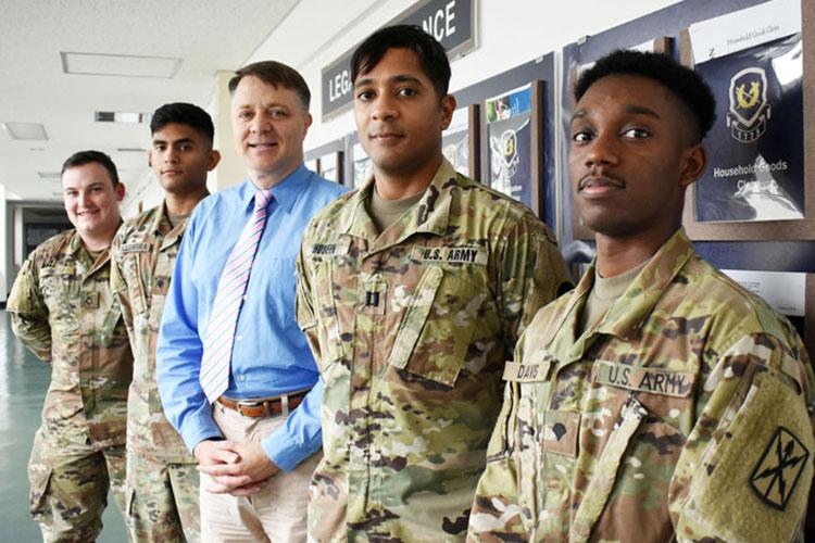 From left, Pfc. Joshua Knightstep, paralegal; Spc. Michlo Bocanegra, paralegal; Kent Herring, attorney and legal assistance director; Capt. Anthony Hosein, legal assistance attorney; and Spc. Damani Davis, paralegal, pose for a photo outside the U.S. Army Japan Legal Assistance Office at Camp Zama July 8. The office won the Army Chief of Staff Award for Excellence in Legal Assistance for fiscal 2018. (Photo Credit: Wendy Brown, U.S. Army Garrison Japan Public Affairs)