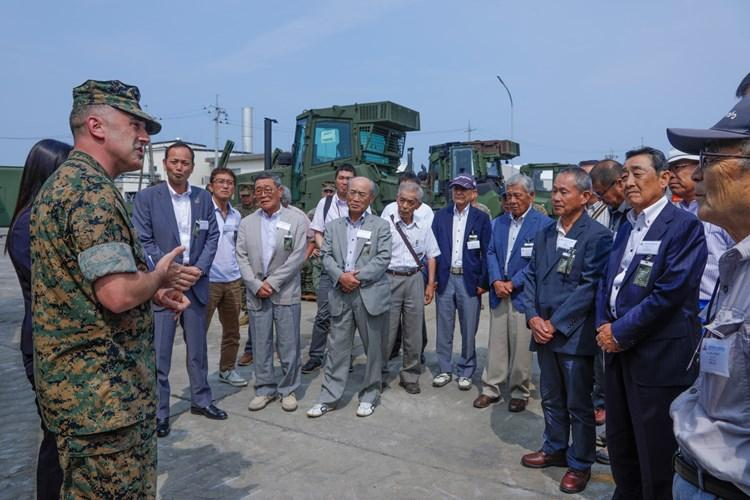 U.S. Marine Corps Lt. Col. Brady Petrillo, the commanding officer of Marine Wing Support Squadron 171, speaks during the Sound of Freedom Campaign with Nagi Town officials at MCAS Iwakuni, July 17, 2019. The visit consisted of a tour through the air station to give guests a better understanding of base operations. (U.S. Marine Corps photo by Pfc. Triton Lai)