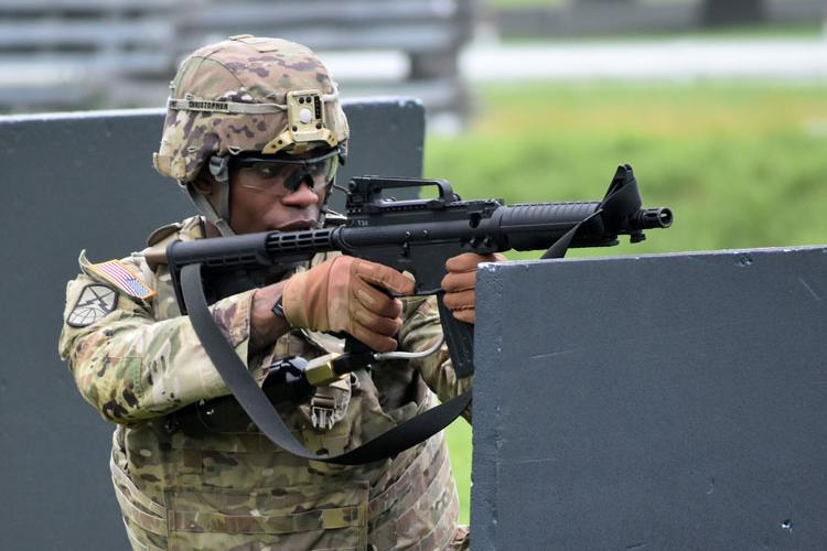 Sgt. Jordan Christopher, assigned to the 35th Combat Sustainment Support Battalion, competes in the react-to-contact portion of the U.S. Army Japan Best Warrior Competition at Sagami General Depot, Japan, July 21. (Photo Credit: Winifred Brown)