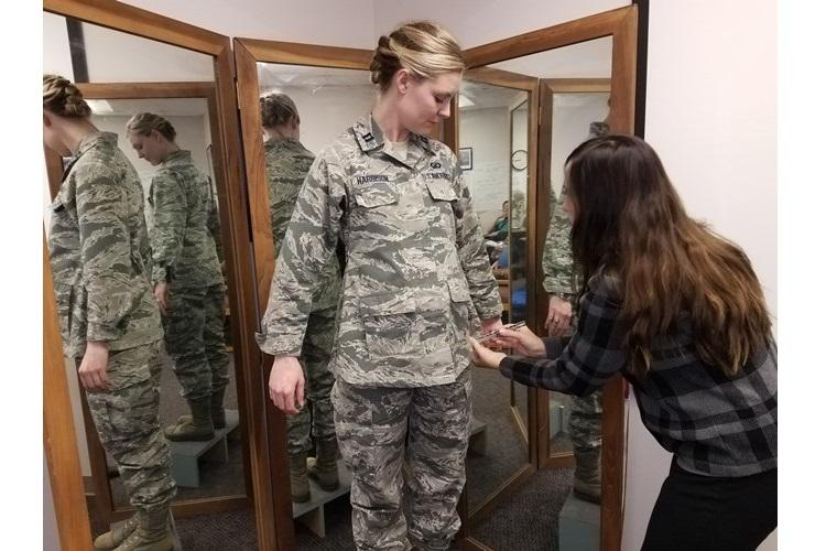 Stacey Butler, right, a clothing designer with the Air Force Life Cycle Management Center's Air Force Uniform Office, measures Capt. Taylor Harrison's maternity Airman Battle Uniform. The new uniforms were designed and developed by the office and are available to pregnant Airmen around the world. (U.S. Air Force photo by Brian Brackens)