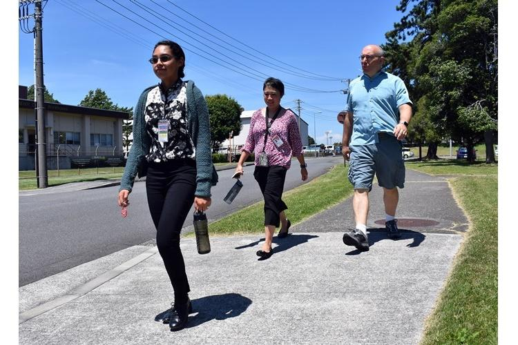 From left, Crescenda Iriarte, a health promotion technician at the Camp Zama Wellness Center; Shannon Vo, a health educator at the center; and Stephen Harmon, a retired Army musician, and participate in a Triad Tuesday Walk at Camp Zama, Japan, Aug. 6. (Photo Credit: Wendy Brown, U.S. Army Garrison Japan Public Affairs)