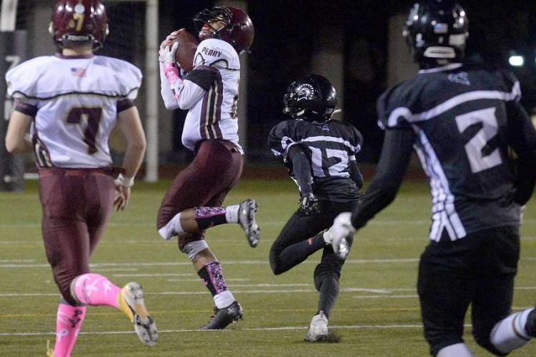 Matthew C. Perry receiver Shion Fleming hauls in his fourth TD catch. (Dave Ornauer/Stars and Stripes)