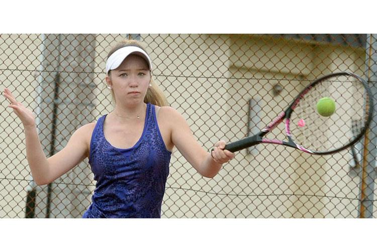 Reigning DODEA-Japan girls singles tennis champion Jenna Mahoney, a Robert D. Edgren sophomore, is hoping to advance past the quarterfinal round of this season's Far East tournament. (DAVE ORNAUER/STARS AND STRIPES)