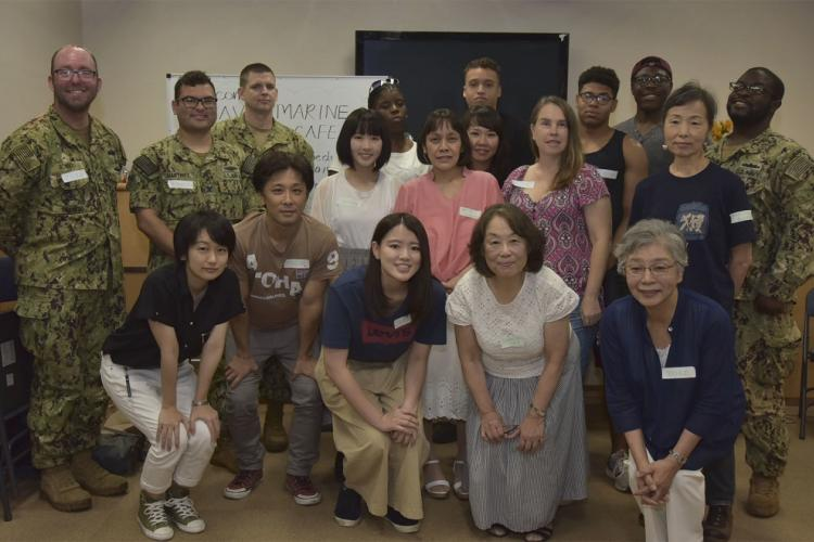 "YOKOSUKA "" Sailors from Commander, Fleet Activities Yokosuka (CFAY) and other Yokosuka-base commands met with Japanese civilians during a community relations event called the Navy Caf© that kicked off at the CFAY Japan U.S. Cultural Exchange Center, July, 25. CFAY provides, maintains, and operates base facilities and services in support of 7th Fleet's forward-deployed naval forces, 71 tenant commands, and 27,000 military and civilian personnel and their families. (U.S. Navy photo by Edward L. Holland)"