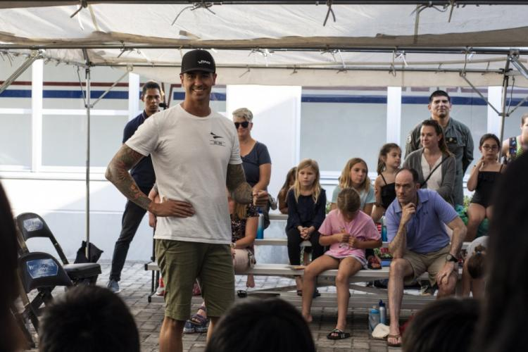 U.S. Olympic swimmer Anthony Ervin speaks to Japanese and American children at Marine Corps Air Station (MCAS) Iwakuni, Japan, Aug. 26, 2019. Ervin spoke to children from local Japanese swim teams and the MCAS Iwakuni Tsunami swim team during a State Department sponsored visit to various locations in Japan. The purpose of Ervin's visit was to inspire children, teach them how to swim better, and provide insight into what it is like to be an Olympian. (U.S. Marine Corps photo by Cpl. Andrew Jones)