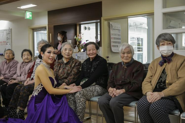 Japan Maritime Self-Defense Force (JMSDF) Petty Officer 3rd Class Naoko Kishi, center, a public relations specialist from Sasebo Naval Base, poses for a photo with local Japanese residents in Iwakuni City, Japan, Feb. 5, 2019. U.S. and JMSDF service members visited the nursing homes to experience traditional Japanese culture and strengthen bonds with their host nation. (U.S. Marine Corps photo by Cpl. Stephen Campbell)