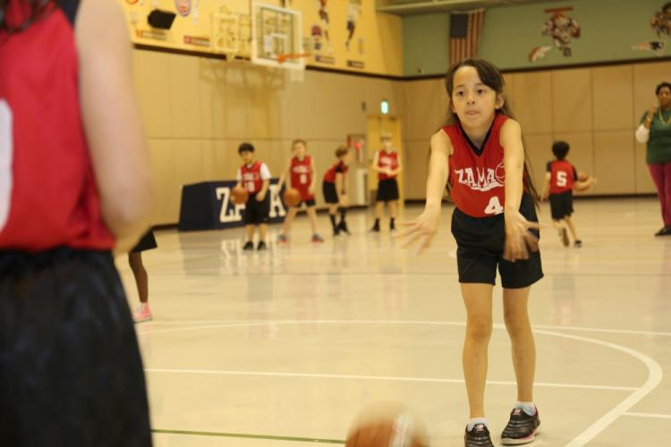 "Members of a basketball team in Camp Zama's Youth Sports and Fitness program practice at the Camp Zama Youth Center. The YSF program was awarded the ""Better Sports for Kids Quality Program Provider"" designation in December 2018 for its stellar administration of youth sports programming. (File photo by Noriko Kudo, U.S. Army Garrison Japan Public Affairs)"