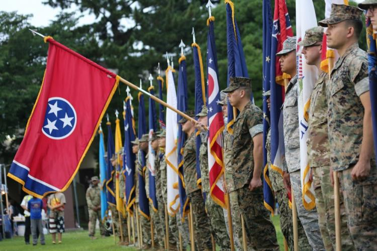 "The Tennessee state flag is presented during the ""Salute to the Nation"" ceremony held as part of the annual open-post Independence Day celebration June 29 on Camp Zama."