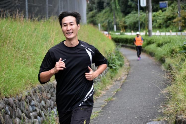 """James Chang, school nurse at John O. Arnn Elementary School, nears Gate 1 at Camp Zama, Japan, Oct. 27, 2019, after completing the first leg of the 20th annual """"Smile Run"""" in honor of Maj. John O. Arnn."""