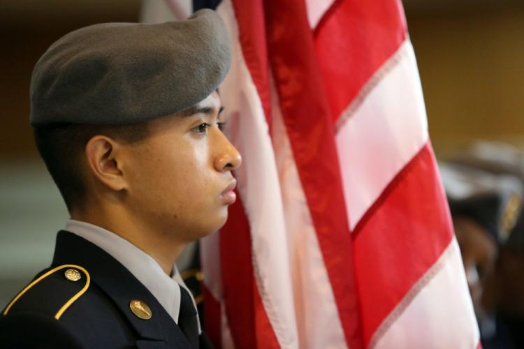 Cadet Pvt. Michael Manangan, a member of the Zama Middle High School Junior Reserve Officers' Training Corps drill team, competes in the Pacific East District Kanto Plains Drill and Color Guard Competition at the Yano Fitness Center, Camp Zama, Oct. 26, 2019.