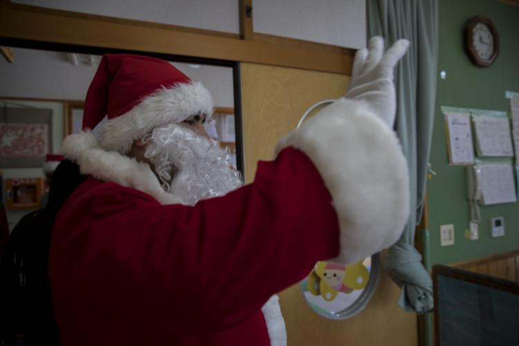 Santa waves goodbye to the children of Josho Hoikuen Preschool in Iwakuni City, Japan, December 10, 2019. This event is among multiple events aboard MCAS Iwakuni during the holidays that promotes camaraderie and holiday cheer for military members and their families while being stationed overseas. (U.S. Marine Corps photo by Lance Cpl. Trista Whited)