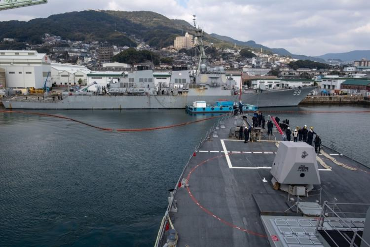 PACIFIC OCEAN (Feb. 8, 2020) The Arleigh Burke-class guided-missile destroyers USS Rafael Peralta (DDG 115) and USS Russell (DDG 59) pull into Sasebo, Japan Feb. 8, 2020. Rafael Peralta and Russell, part of the Theodore Roosevelt Carrier Strike Group, is in Sasebo for a port visit during their scheduled deployment to the Indo-Pacific. (U.S. Navy photo by Mass Communication Specialist 2nd Class Jason Isaacs)