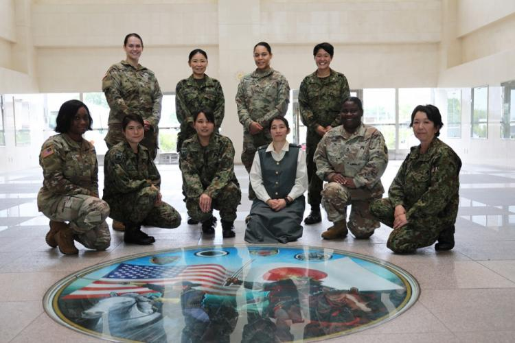 U.S. Army Soldiers and Japan Ground Self-Defense Force members pose for a group photo June 24 inside the JGSDF building on Camp Zama, Japan. The group met for an inaugural exchange program to discuss their experiences as women in their respective workforces. The bilateral discussion, the first of its kind on the installation, covered topics such as career development, child care, and balancing work and home life.