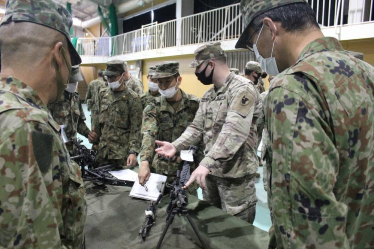 A Soldier of the 14th Missile Defense Battery, Kyogamisaki Communication Site, Kyotango-Shi, Japan, instructs soldiers of the Japan Ground Self-Defense Force on the operation of a crew-served machine gun during a U.S.-Japan multinational joint force field training exercise, Nov. 2-3. The battery is operated by the U.S. Army Space and Missile Defense Command's 1st Space Brigade. (Courtesy photo)