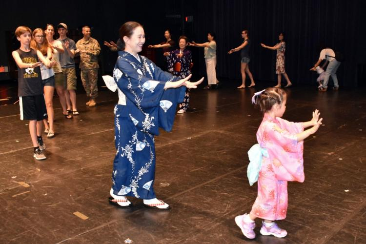 Members of the Camp Zama community learn a Bon dance at the Community Recreation Center, Camp Zama, Japan, July 18, 2019.