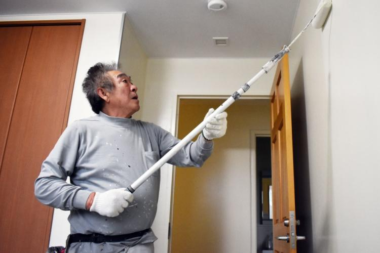 A U.S. Army Garrison Japan Directorate of Public Works contractor paints an interior on Sagamihara Family Housing Area, Japan, Dec. 13, 2019.