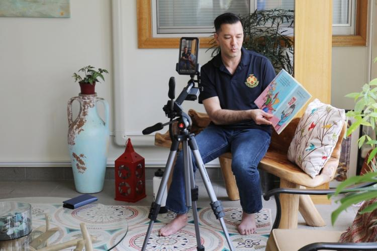 """Col. Thomas Matelski, commander of U.S. Army Garrison Japan, reads """"Llama Llama Loves to Read"""" by Anna Dewdney at Camp Zama, Japan, April 10, a day off for Soldiers. Matelski read the story for the Camp Zama Family and Morale, Welfare and Recreation's livestreamed Story Time initiative."""