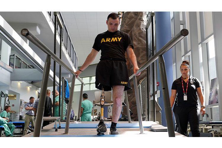 Army Spc. Ezra Maes undergoes physical rehabilitation at the Center for the Intrepid, Brooke Army Medical Center's cutting-edge rehabilitation center on Joint Base San Antonio-Fort Sam Houston, Oct. 2, 2019. (U.S. Army photo by Corey Toye)