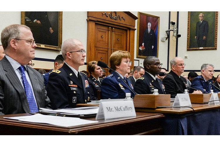 Speaking before the House Armed Services subcommittee on personnel during a Dec. 5 hearing on Capitol Hill, Assistant Secretary of Defense for Health Affairs Thomas McCaffrey (left), Army Lt. Gen. (Dr.) Ronald Place (second from left), director of the DHA, the service Surgeons General, and Joint Staff Surgeon outlined the necessity for the health care system to change in order to support warfighter readiness. (MHS photo)