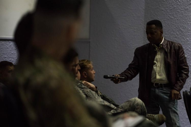 Retired Chief Master Sgt. Anthony Brinkley speaks to service members at Yokota Air Base, Japan February 8, 2019 in the base theater. Brinkley served 28 years in the Air Force, 12 as a first sergeant, before retiring and pursuing a life as a motivational speaker.