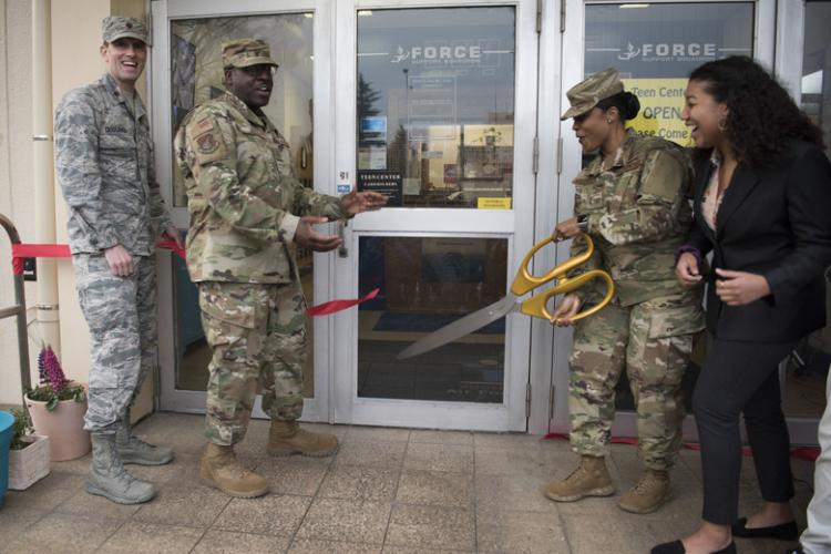 Yokota leadership cut the ribbon during the reopening of the Teen Center, Mar. 15, 2019, at Yokota Air Base, Japan. The Teen Center features various activities for teens between the ages of 13-18 Monday through Friday after school. (U.S. Air Force Photo by Senior Airman Kevin West)