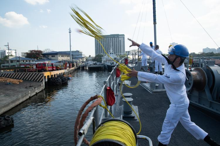 MANILA, Philippines (March 17, 2019) - Mineman Seaman Logan Hardy, from Millbrook, Alabama, throws a messenger line to the pier to moor the Avenger-class mine countermeasures ship USS Chief (MCM 14) as the ship arrives in Manila, Philippines, for a port visit. Chief is visiting Manila while operating in the U.S. 7th Fleet area of operations to work with their Philippine Navy counterparts to strengthen regional security and stability, and enhance interoperability. (Photo by MC2 Jordan Crouch)