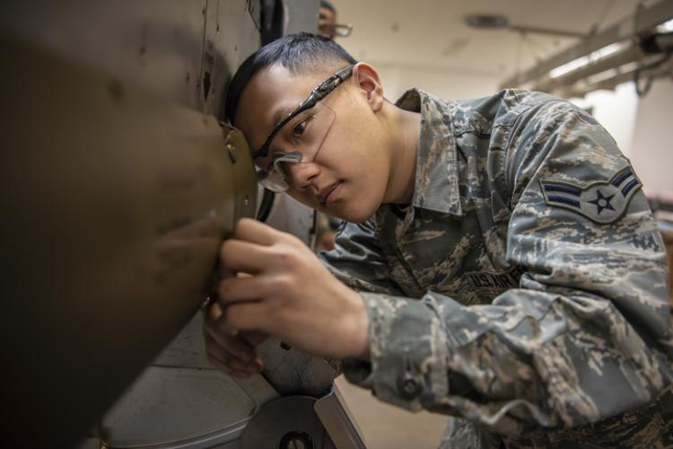U.S. Air Force Airman 1st Class Chrisjian Yang, a 35th Maintenance Squadron electronic warfare journeyman, inspects a heat exchanger fin for foreign object debris at Misawa Air Base, Japan, March 20, 2019. The ALQ-184 electronic countermeasure pod increases reception range, reduces countermeasure response time and improves reliability. (U.S. Air Force photo by Airman 1st Class Xiomara M. Martinez)