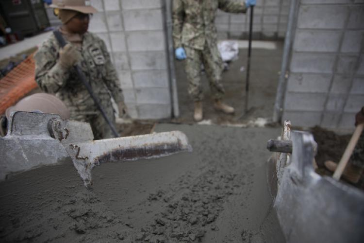 U.S. Navy Seabees with Naval Mobile Construction Battalion 3, Detachment Iwakuni pour concrete for trash enclosures at Marine Corps Air Station Iwakuni, Japan, March 19, 2019. NMCB-3 Detachment Iwakuni is deployed from their base in Port Hueneme California. The Seabees deployed to Iwakuni in order to build 27 garbage enclosure structures that protect solid waste containers from wind and wildlife while maintaining a neat appearance to garbage collection areas. (U.S. Marine Corps photo by Cpl. Andrew Jones)
